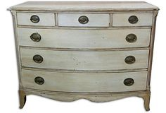 Here's a dresser painted light gray, then antique glazed in black. I think this color would look much better with your marble counter.