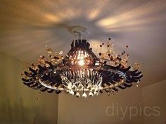 Make a Chandelier out of Hangers.  Remarkable diy using plastic hangers/ bicycle rim...somewhat clumsy video... but the results are remarkable... another, weather friendly lighting idea for patio structures