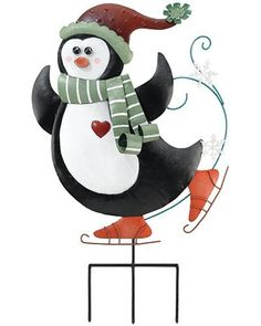 """Christmas Penguin Stake / Wall Decor by Garden Fun. $26.95. Christmas has arrived, and so has our fun loving Christmas Penguin Stake / Wall Decor! On whimsical stakes with Christmas cap, this skating penguin will bring joy to your holiday yard. With scarf, snowflakes, and his heart on his sleeve this all metal design comes with a removable garden stake, and allows you to also hang it on your door, garden wall or fence. Simple and fabulous! Size: 15""""W x 19.5"""" (abo..."""