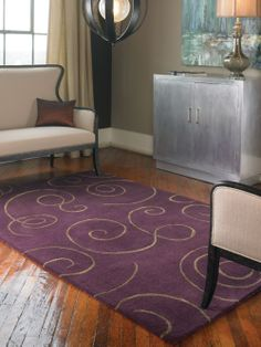 Beautiful contemporary area rug with over dyed dark purple wool and viscose blend accented with taupe scroll motifs. Available in 5 x 8 and 8 x 10.