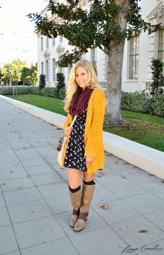 mustard sweater, print dress and riding boots #fashion