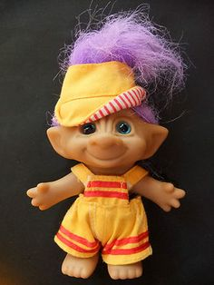 TROLL DOLL with Cap and Yellow Overalls with Purple Gem from Ace Novelty.