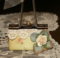 Shabby Beautiful Scrapbooking I altered this 2 inch binder clip to look like a purse.. These would make great place card holders for  a bridal shower