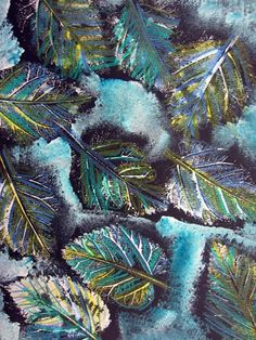 printmaking lesson to 4th graders using leaves and white tempera paint. The vein side of the leaf was inked with a big brush and white paint. Composition and positive and negative space was emphasized. Some students used overlapping to create depth. The background was sponge painted with white and blue leaving black around the edges of the leaves to create contrast. Colored pencils were used to add color to the leaves.