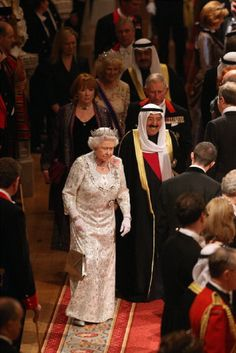 The Amir Sheikh Sabah Al-Ahmad Al-Jaber Al-Sabah of Kuwait accompanies Queen Elizabeth II as they arrive for a State Banquet in Windsor Castle