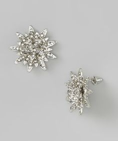 Add a gleaming accent to the day with these striking earrings. Shining rhinestones adorn the petals of exuberant blossoms, crafting an attention-getting addition to a stylish ensemble.