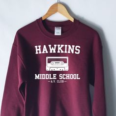 Hawkins Middle School AV Club Sweatshirt - Stranger Things Shirt - Stranger Things Tee - Jumper - Eleven Hopper by WildHeartsUSA on Etsy https://www.etsy.com/listing/465187912/hawkins-middle-school-av-club-sweatshirt - black and white plaid mens shirt, guys casual shirts, casual mens shirts *ad