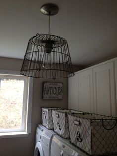 Love the wire basket light fixture in this laundry room.