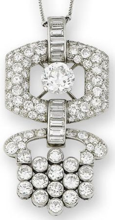 An art deco diamond pendant, circa 1930.  Centrally set with an old brilliant-cut diamond, weighing 3.26 carats, within a buckle-shaped surround pavé-set with similarly cut diamonds and suspending a further openwork drop set with brilliant and baguette-cut diamonds, remaining diamonds approximately 5.80 carats total.