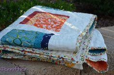 Orange and blue quilt folded