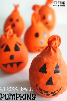 Halloween calm down balls or stress balls made out of balloons. Fun Jack O lantern activity for kids that uses sensory play.