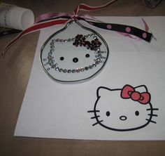 Hello Kitty Christmas Ornament - used a print out from the internet under a clear glass ornament and placed & glued jewels on top of lines as a guide.  Turned out pretty cute for a sweet little friend about 5 years ago.