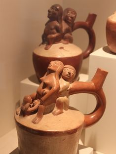 Moche sculptural stirrup spout bottle Moche (Mochica) Culture AD) Sculptural stirrup spout bottle depicting childbirth click the image for more details. Colombian Art, Birth Art, Peruvian Art, Ancient Goddesses, Mesoamerican, Inca, Greek Art, Ancient Artifacts, Ceramic Painting