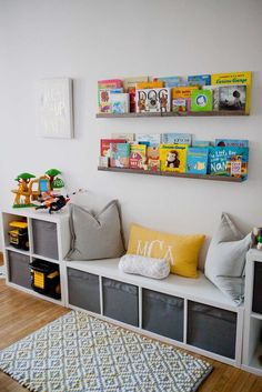 IKEA storage is king in this play room. The book rail displays colorful and beloved children's books in the kids' playroom. IKEA storage is king in this play room. The book rail displays colorful and beloved children's books in the kids' playroom. Room Ideas Bedroom, Kids Bedroom Storage, Ikea Toy Storage, Book Storage Kids, Storage Ideas For Kids, Ikea Childrens Storage, Living Room Storage Ideas For Toys, Storage For Playroom, Shelving For Kids Room