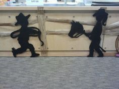 """These were my favorite silhouettes...We put these near the preschool counter...for the """"Little Cowfolks!""""....These were on pretty thick cardboard that we painted black...we cut most of silhouettes out with a box cutter but this one required a jigsaw..."""