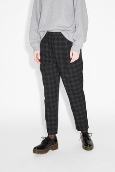 Relaxed, tapered trousers cut from an Oxford professor-ish check fabric. Hook…