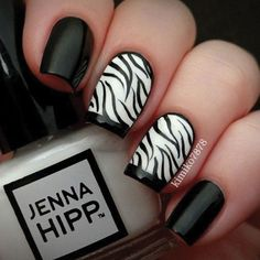 We are obsessed with zebra nail look from Kimiko7878. Instead of one statement nail, she used two. Not only that, but she added a black french tip to her zebra print nails which make it look super classy. Plus, the design isn't overpowering because she painted her other nails in just plain black. This fashion-forward design will work for a variety of occasions and pairs nicely with a red (or other brightly colored) dress.