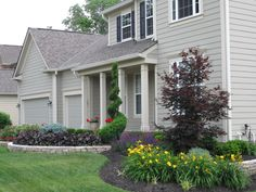 After - Lush Front Yard Landscaping with swaths of perennial color.