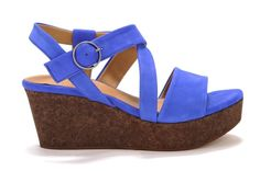 Mel by Coclico Stunning cobalt blue and a dark cork wedge make this sandal unique, modern, and absolutely one-of-a-kind. Pair it with corals, white, yellows and florals for a look that's striking yet totally wearable. •  Suede  upper•  Padded leather footbed•  Dark cork wedge•  Rubber sole•  Made in Spain •  Measurements:-  Heel height: 2 3/4 in- Platform height:  1 1/2  in