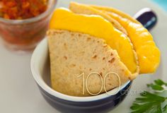 Mini Quesadilla    You may not expect cheese quesadillas to make a list of low-calorie snacks, but try this recipe: sprinkle an ounce of grated low-fat cheddar cheese over a corn tortilla. Fold in half and microwave for 20 seconds. This quick and tasty snack has only 100 calories and 1.3 g of saturated fat.  Saturated Fat: 1.3 g  Sodium: 182 mg  Cholesterol: 6 mg