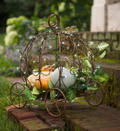 I LOVE THIS!!  Light-Up Pumpkin Carriage Garden Planter | Decorative Containers | Our Light-Up Pumpkin Carriage Planter will turn your landscape into a modern-day fairytale with its elaborately-scrolled design. Delicate string lights twinkle against the frame, radiating a feeling of magical mystery. Show off blossoming plants or gourds day and night with convenient auto timer that turns lights on for 6 hours, off for 18.