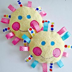 This simple template and tutorial shows you how to create a soft and snuggle basic baby toy with ribbons