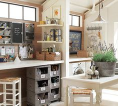 combination laundry room and craft room with a common table