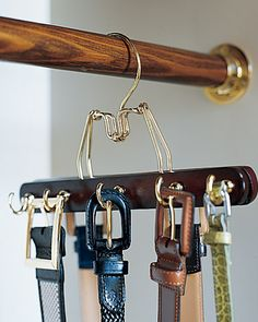 Portable Hooks  To create a belt rack that matches your other hangers (and doesn't require making holds in the wall), try this: Predrill a row of holes in alternating spots on both sides of a wooden clamp hanger, and screw in cup hooks.