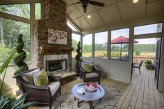 screened porch with fireplace.