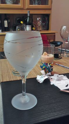 Ah sorry for all the mess on the table, but what I am showing is the frosted wine glass that used to look like the one on the far right!
