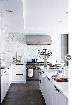 FOR THE HOME || White kitchen with dark wood flooring & marble herringbone tile splash back || NOVELA BRIDE...where the modern romantics play & plan the most stylish weddings... http://www.novelabride.com /novelabride/ #jointheclique