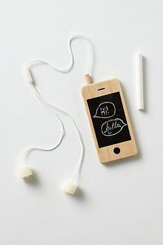 iwoody iphone | with soft, spongy ear buds that double as chalkboard erasers, this toy smart phone, crafted of natural wood, is perfect for occupying little hands while mom and dad are on the phone. Includes one piece of chalk.