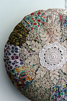 Round pillow made with Liberty prints and crochet doily accents.