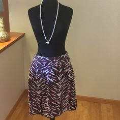 """Beautiful multi-purple skirt Love the fabric, the pattern, and the kaleidoscopic fusion of purple hues.  Fully lined, with a double banded waist (see pics).  29"""" long.  A treat.  Feels festive in mood, like seeing cotton candy.  (Pearls not included.) Merona Skirts"""