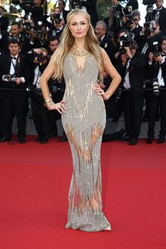 Paris Hilton: Paris Hilton brought the shimmer to the red carpet in a gold body-hugging Yousef Al-jasmi gown, and she piled on plenty of complementing accessories: chunky bracelets, a ring, and a choker necklace.#Cannes2015