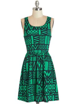 Land of Applause Dress. While this dress' vibrant shade of green matches the brilliance of the pastures, its patchwork of navy chevron prints take on the liveliness of the busy city. #green #modcloth