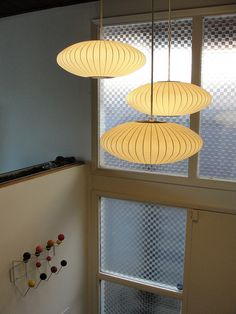 George Nelson Bubble Lamps in entrance area. Eames coat hook on wall.
