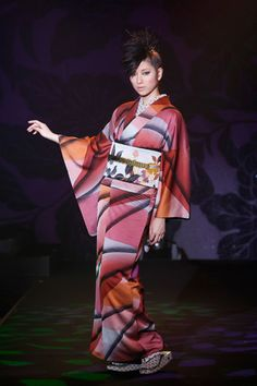 """A recent kimono creation by designer Jotaro Saito.  Born in Kyoto, Jotaro Saito says he made his debut at the age of 27 as Japan's youngest kimono designer. He seeks to bring the traditional Japanese Kimono into the modern world, to be worn by young people as """"real clothes""""."""