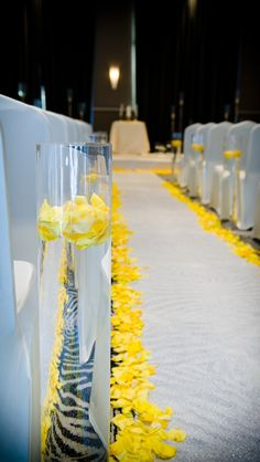 Cute and simple yellow floral aisle markers by Southern Event Planners in Memphis, TN