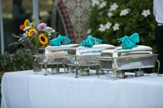 Buffet. Silver chaffing dishes with a napkin tied around the handle for a personalized touch. Photo credit: Gloria Mesa Photography