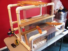 Blog showing how to build your own weaving loom using PVC pipe.-wouldn't this be awesome? --- must show this to peachy.
