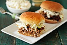 Easy Crockpot Pulled Pork. It's simple, delicious, and most importantly can be slow cooked all day in the crockpot which requires very little effort. | My Baking Addiction