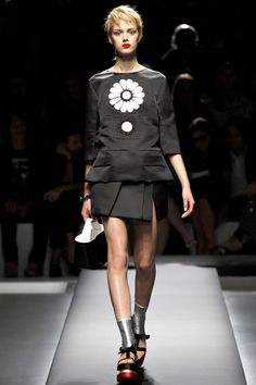 Prada spring '13: black satin top with flower, with matching short wrap skirt