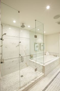 Meredith Heron designer.  Personally would extend the tub deck into the shower for a bench.  Would have to shorten the length of the shower.