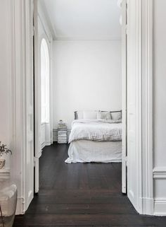 Serene bedroom with dark wooden floor