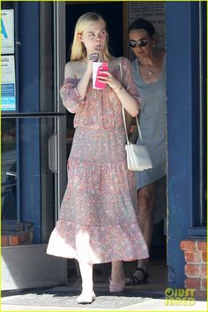 Elle Fanning stops for a sweet drink while out doing some retail therapy with her mom Joy on Wednesday afternoon (August 27) in Los Angeles.