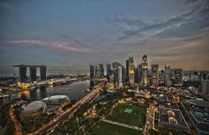 singapore city skyline dusk panorama***Singapore has one of the busiest ports in the world and is the world's fourth largest foreign exchange trading center. Singapore Map, Visit Singapore, Singapore Business, Singapore Photos, The Tourist, Countries Of The World, Skyscraper, Around The Worlds, Marina Bay