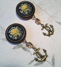 Kind of wish my ears were gaged so I could wear these. Vintage Navy and Ivory Floral Cameo Dangle by BlueSwallowDesign, £22.99