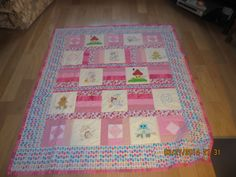 Floor quilt with embroidery.  made for liadan.