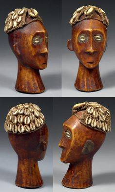 Africa | Stylised head from the Lega people of DR Congo | Ivory, resin, natural fiber and cowrie shells | ca. late 19th to early 20th century | H: 15,5 cm